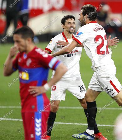 Sevilla's Franco 'El Mudo' Vazquez (R) celebrates with teammates after scoring the 2-0 lead during the Spanish La Liga soccer match between Sevilla FC and Elche CF at Ramon Sanchez Pizjuan stadium in Seville, Spain, 17 March 2021.