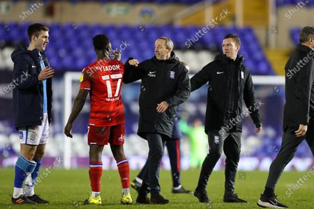 Birmingham City Head Coach Lee Bowyer, taking charge of his side for the first time, flanked by coach Craig Gardner, fist bumps Andy Yiadom of Reading