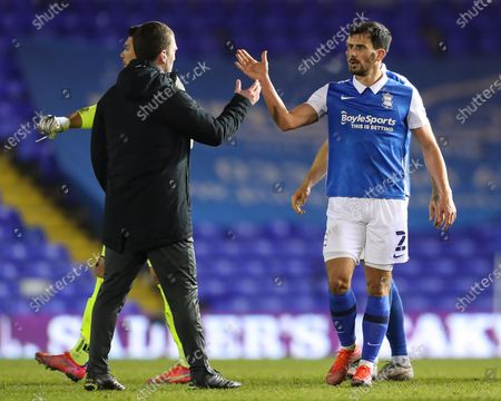 George Friend of Birmingham City high fives coach Craig Gardner after the final whistle