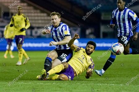 Huddersfield Town forward Fraizer Campbell (22) tackles Sheffield Wednesday defender Tom Lees (15) during the EFL Sky Bet Championship match between Sheffield Wednesday and Huddersfield Town at Hillsborough, Sheffield
