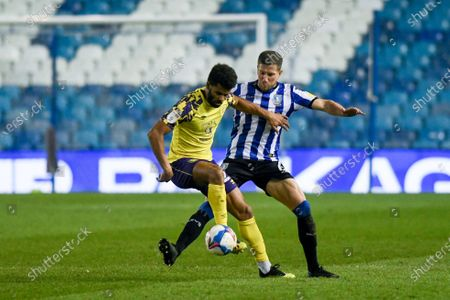Huddersfield Town forward Fraizer Campbell (22) and Sheffield Wednesday defender Sam Hutchinson (6) in action during the EFL Sky Bet Championship match between Sheffield Wednesday and Huddersfield Town at Hillsborough, Sheffield