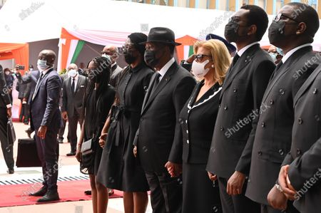 Stock Photo of Ivorian president Alassane Ouattara (4R) and his wife Dominique Folloroux-Ouattara (3R) attend Ivory Coast's late Prime Minister Hamed Bakayoko official tribute ceremony at the presidential palace in Abidjan, Iory Coast, 17 March 2021. Ivory Coast's Prime Minister Hamed Bakayoko died on March 10, 2021 following a cancer treatment in a German hospital.