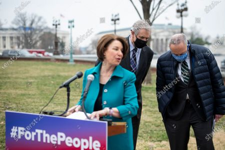 United States Senator Amy Klobuchar (Democrat of Minnesota) offers remarks while joined by United States Senator Jeff Merkley (Democrat of Oregon), center, and United States Senate Majority Leader Chuck Schumer (Democrat of New York), right, during a press conference regarding the For The People Act at the U.S. Capitol in Washington, DC,.