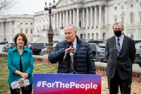 United States Senate Majority Leader Chuck Schumer (Democrat of New York), center, is joined by United States Senator Amy Klobuchar (Democrat of Minnesota), left, and United States Senator Jeff Merkley (Democrat of Oregon), right, during a press conference regarding the For The People Act at the U.S. Capitol in Washington, DC,.