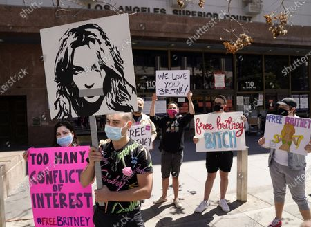 Britney Spears fans gather outside a court hearing concerning the pop singer's conservatorship at the Stanley Mosk Courthouse, in Los Angeles. Attorneys for Spears and lawyers for her father Jamie Spears jointly asked the judge to delay an accounting and status report on the conservatorship until April 27