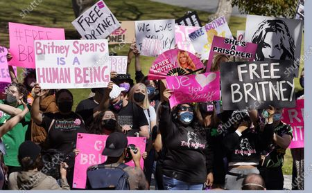 Britney Spears fans hold signs outside a court hearing concerning the pop singer's conservatorship at the Stanley Mosk Courthouse, in Los Angeles. Attorneys for Spears and lawyers for her father Jamie Spears jointly asked the judge to delay an accounting and status report on the conservatorship until April 27