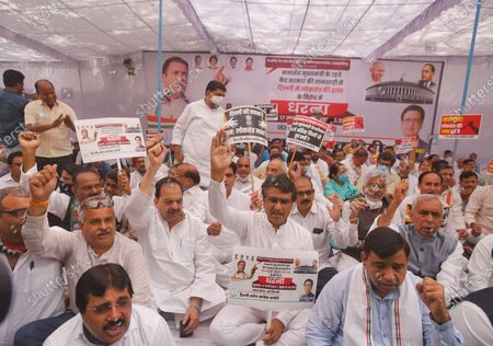 """DPCC President Anil Kumar Chaudhary along with Congress supporters raise slogans during a protest against the central government over the Government of National Capital Territory of Delhi (Amendment) Bill 2021 (GNCTD) that confers more powers to the Lieutenant Governor at Jantar Mantar, on March 17, 2021 in New Delhi, India. Union minister of state for home G Kishan Reddy introduced the Bill in the Lower House on Monday. The Bill says the """"government"""" in Delhi will mean the L-G in the context of all legislation passed by the city-state's assembly. It makes it mandatory for the city government to seek the L-G's opinion before any executive action."""