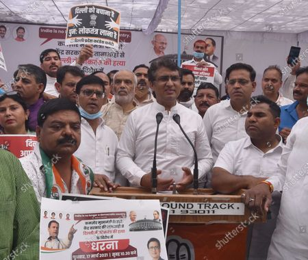 """DPCC president Ch. Anil Kumar choudhary address the Congress workers protest against the central government over the Government of National Capital Territory of Delhi (Amendment) Bill 2021 (GNCTD) that confers more powers to the Lieutenant Governor at Jantar Mantar on March 17, 2021 in New Delhi, India. Union minister of state for home G Kishan Reddy introduced the Bill in the Lower House on Monday. The Bill says the """"government"""" in Delhi will mean the L-G in the context of all legislation passed by the city-state's assembly. It makes it mandatory for the city government to seek the L-G's opinion before any executive action."""