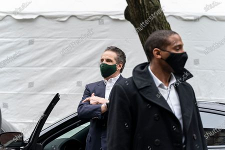 New York State Governor Andrew Cuomo leaves Mount Neboh Baptist Church in Harlem after touring it, making an announcement and receiving the Johnson & Johnson vaccine. Governor waved to the waiting press and shouted to passersby to encourage them to get vaccinated.