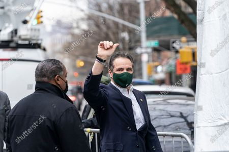 New York State Governor Andrew Cuomo arrives to Mount Neboh Baptist Church in Harlem for touring it, making an announcement and receiving the Johnson & Johnson vaccine. Governor waved to the waiting press and shouted to passersby to encourage them to get vaccinated.