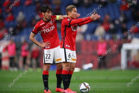 Stock Image of (L to R)  Yuki Abe,  Ryosuke Yamanaka (Reds) - Football / Soccer :  2021 J1 League match  between Urawa Red Diamonds 0-0 Hokkaido Consadole Sapporo  at Saitama Stadium 2002, Saitama, Japan.
