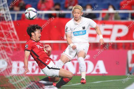 (L to R)  Yuki Abe (Reds),  Daiki Suga (Consadole) - Football / Soccer :  2021 J1 League match  between Urawa Red Diamonds 0-0 Hokkaido Consadole Sapporo  at Saitama Stadium 2002, Saitama, Japan.