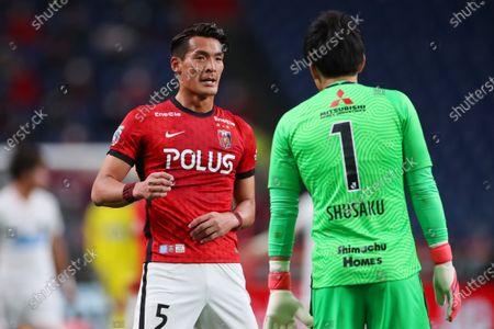 (L to R)  Tomoaki Makino,  Shusaku Nishikawa (Reds) - Football / Soccer :  2021 J1 League match  between Urawa Red Diamonds 0-0 Hokkaido Consadole Sapporo  at Saitama Stadium 2002, Saitama, Japan.