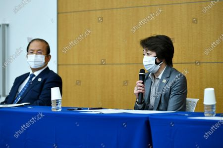 """Seiko Hashimoto, president of the Tokyo 2020 Organizing Committee of the Olympic and Paralympic Games, speaks as Tokyo 2020 CEO Toshiro Muto, left, listens during a press conference regarding its creative director's comments about a well-known female celebrity, in Tokyo . Tokyo Olympics creative director Hiroshi Sasaki is resigning after making demeaning the comments. Sasaki, who was in charge of the opening and closing ceremonies for the Olympics, told planning staff members last year that well-known entertainer Naomi Watanabe could perform in the ceremony as an """"Olympig"""