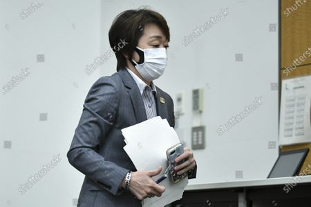 Stock Image of Tokyo 2020 President Seiko Hashimoto leaves a press conference regarding a Japanese weekly magazine reporting about alleged derogatory comments made by Hiroshi Sasaki, creative director for the Olympic opening and closing ceremonies, in Tokyo, Japan, 18 March 2021. Sasaki quit on 18 March after a magazine reported that he had suggested Japan's plus-size fashion icon Naomi Watanabe to be dressed as a pig during the Olympic opening ceremony.