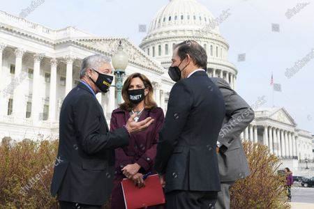 Stock Picture of Representative Carlos Gimenez(R-FL)(left) and Maria Elvira Salazar(R-FL)(center) talk with their colleagues during a press conference about Immigration Reform Bill today on March 17, 2021 at House Triangle/Capitol Hill in Washington DC, USA.  (Photo by Lenin Nolly/NurPhoto)