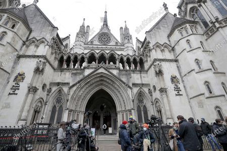 Media wait outside the High Court in London, . Johnny Depp's bid to overturn a damning ruling that he assaulted his ex-wife Amber Heard and put her in fear for her life will be considered by the Court of Appeal on Thursday