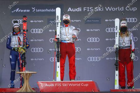 Switzerland's Lara Gut-Behrami, center winner of the alpine ski, women's World Cup super G discipline title, poses on the podium with second placed Italy's Federica Brignone, left, and third placed Switzerland's Corinne Suter, in Lenzerheide, Switzerland