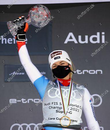 Switzerland's Lara Gut-Behrami holds up the trophy of the alpine ski, women's World Cup super-G discipline title, in Lenzerheide, Switzerland