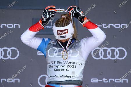 Switzerland's Lara Gut-Behrami wear the medal of of the alpine ski, women's World Cup super-G discipline title, in Lenzerheide, Switzerland