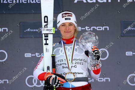 Switzerland's Lara Gut-Behrami holds the trophy of the alpine ski, women's World Cup super-G discipline title, in Lenzerheide, Switzerland