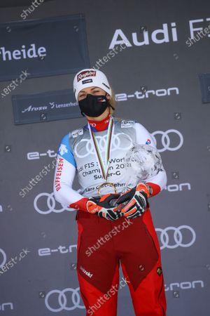 Switzerland's Lara Gut-Behrami poses with the trophy of the alpine ski, women's World Cup super-G discipline title, in Lenzerheide, Switzerland