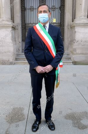 Mayor Giuseppe Sala Commemorates the fallen of the pandemic for Covid 19 in Piazza Scala in front of the flags at half mast of Palazzo Marino