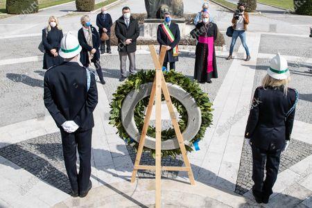 Major of Brescia, Emilio del Bono (with the Majoral crest) and the city bishop Pierantonio Tremolada (right) in Brescia, Italy on 18 March 2021 attend the first national day in memory of the victims of Covid 19.