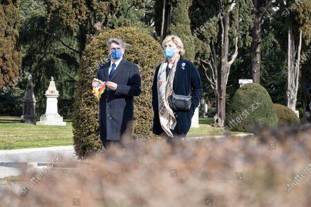 Major of Brescia, Emilio del Bono (far left) walks in the city cemetery in Brescia, Italy on 18 March 2021 attends the first national day in memory of the victims of Covid 19.