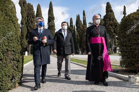 Stock Photo of Major of Brescia, Emilio del Bono (left) walks in the city cemetery with the city bishop Pierantonio Tremolada (right)  in Brescia, Italy on 18 March 2021 attend the first national day in memory of the victims of Covid 19.