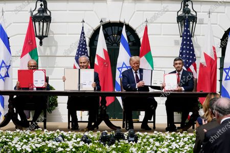 From left; Bahrain Foreign Minister Khalid bin Ahmed Al Khalifa, Israeli Prime Minister Benjamin Netanyahu, U.S. President Donald Trump, and United Arab Emirates Foreign Minister Abdullah bin Zayed al-Nahyan, sit during the Abraham Accords signing ceremony on the South Lawn of the White House, in Washington. As Israel heads to the polls next week for the fourth time in two years, Prime Minister Benjamin Netanyahu has sought to capitalize on his new partnership with the United Arab Emirates in his desperate campaign to stay in power