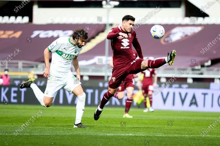 Gian Marco Ferrari of US Sassuolo and Antonio Sanabria of Torino FC  during the Serie A football match between Torino FC and US Sassuolo. Sporting stadiums around Italy remain under strict restrictions due to the Coronavirus Pandemic as Government social distancing laws prohibit fans inside venues resulting in games being played behind closed doors. Torino FC won 3-2 over US Sassuolo