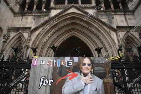 A banner in support of US actor Johnny Depp is displayed outside the Royal Courts of Justice in London, Britain, 18 March 2021. US actor Johnny Depp is appealing the verdict after he lost his case when suing The Sun's newspaper publisher News Group Newspapers (NGN) over claims he abused his ex-wife Amber Heard.