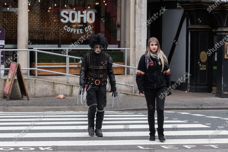 Johnny Depp's supporters, one dressed as the movie character Edward Scissorhands (L), arrive at the Royal Courts of Justice as Johnny Depp's legal team applies for permission to appeal, and to rely on further evidence in a bid to overturn last year's ruling in the libel claim against The Sun and its publisher News Group Newspapers over an article labelling him a wife beater, on 18 March, 2021 in London, England. The ruling by a High Court judge Mr Justice Nicol following a three-week trial in July last year found that the claims in the article were substantially true and that the US actor had assaulted his ex-wife Amber Heard.