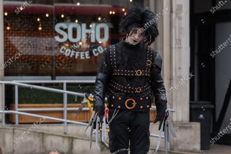 Johnny Depp's supporter dressed as the movie character Edward Scissorhands arrives at the Royal Courts of Justice as Johnny Depp's legal team applies for permission to appeal, and to rely on further evidence in a bid to overturn last year's ruling in the libel claim against The Sun and its publisher News Group Newspapers over an article labelling him a wife beater, on 18 March, 2021 in London, England. The ruling by a High Court judge Mr Justice Nicol following a three-week trial in July last year found that the claims in the article were substantially true and that the US actor had assaulted his ex-wife Amber Heard.