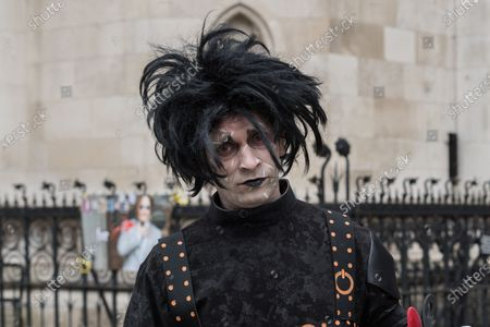 Johnny Depp's supporter dressed as the movie character Edward Scissorhands stands outside the Royal Courts of Justice as Johnny Depp's legal team applies for permission to appeal, and to rely on further evidence in a bid to overturn last year's ruling in the libel claim against The Sun and its publisher News Group Newspapers over an article labelling him a wife beater, on 18 March, 2021 in London, England. The ruling by a High Court judge Mr Justice Nicol following a three-week trial in July last year found that the claims in the article were substantially true and that the US actor had assaulted his ex-wife Amber Heard.