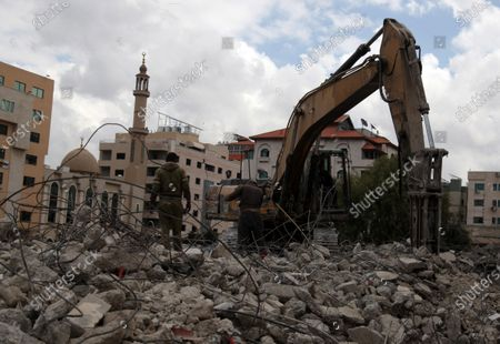 Palestinian workers demolish an old house, in Gaza city on March 18, 2021. A difficult year is already assured even with no further escalation of public health measures. While some measures to curb the movements and gatherings are still in place, the great majority of activity remains open. Assuming that the lockdowns remain limited, the severe first half contraction will likely avoid repetition, though not sufficiently to offset the losses in the first half. Consequently, GDP for 2020 is expected to contract by about 8%. A modest bounce back is expected in the forecast period with growth averaging 2.5% as full normalization of activity is not expected to occur before the second half of 2021. The poverty rate is projected to stall around 27.5% in 2021.
