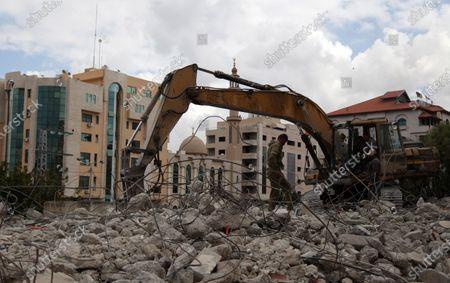 Editorial image of Palestinian workers demolish an old house, Gaza city, Gaza Strip, Palestinian Territory - 18 Mar 2021