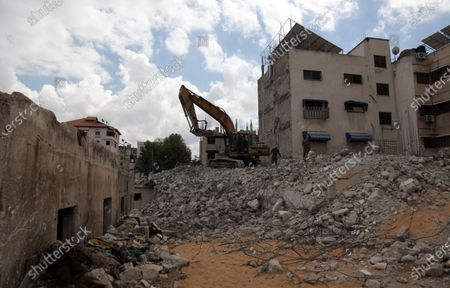 Editorial picture of Palestinian workers demolish an old house, Gaza city, Gaza Strip, Palestinian Territory - 18 Mar 2021
