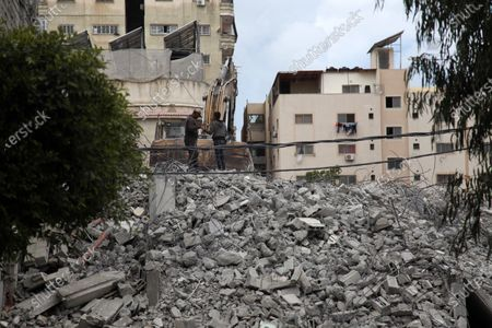 Editorial photo of Palestinian workers demolish an old house, Gaza city, Gaza Strip, Palestinian Territory - 18 Mar 2021