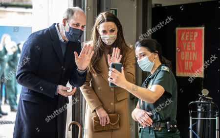 Prince William and Catherine Duchess of Cambridge talk with the family of paramedic Jahrin (Jay) Khan via a mobile phone. The family is in London but her father joined the conversation from Bangladesh. Ms Khan has been unable to see her family through the pandemicThe Royal couple were visiingt Newham ambulance station in East London. During the visit, The Duke and Duchess met with ambulance staff and paramedics to hear more about their experiences of working during the pandemic and about the mental health and wellbeing support provided at the Station and through the London Ambulance Service.