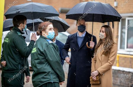 Britain's Prince William and Catherine Duchess of Cambridge, right, talk with members of the ambulance service in the well being garden at Newham ambulance station in London,. The royal couple met with ambulance staff and paramedics about their experiences of working during the pandemic and about support for the mental health of health workers
