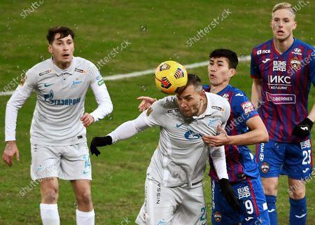 CSKA players Baktiyor Zainutdinov (second right), Hordur Magnusson (right), Zenit players Daler Kuzyaev (left) and Artem Dzyuba (second left)