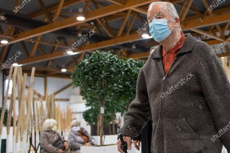 King Albert II of Belgium arrives to receive a Covid-19 vaccine at the vaccination village at the Brussels Expo exposition halls at the Heizel-Heysel site, Thursday 18 March 2021.