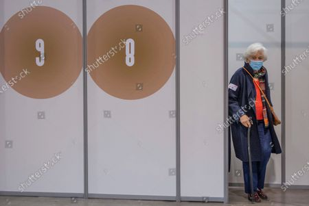 Belgium's Queen Paola leaves the vaccination cubicle after receiving her COVID-19 vaccination at the Brussels Expo vaccine center in Brussels