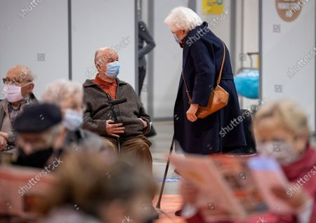 Belgium's King Albert II, rear center, and Queen Paola, rear right, in a waiting room after receiving their COVID-19 vaccinations at the Brussels Expo vaccine center in Brussels