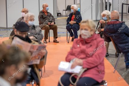 Belgian King Albert II (C-L) and Queen Paola (C-R) visit a vaccination center to be vaccinated against COVID-19 in Brussels, Belgium, 18 March 2021.