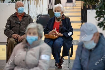Belgian King Albert II (back, L) and Queen Paola (back, R) visit a vaccination center to be vaccinated against COVID-19 in Brussels, Belgium, 18 March 2021.