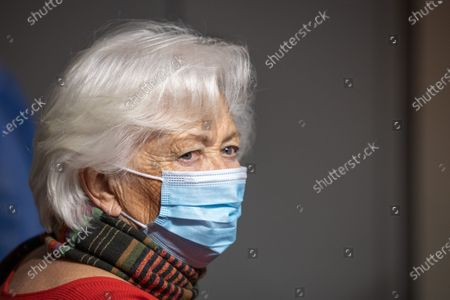 Belgian Queen Paola is vaccinated against COVID-19 at a vaccination center in Brussels, Belgium, 18 March 2021.