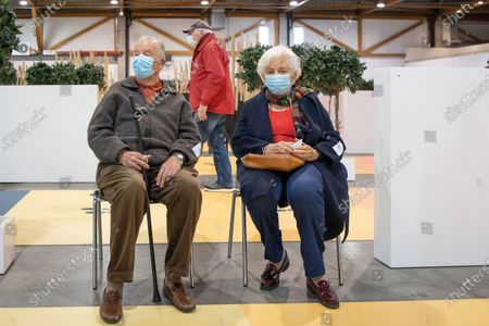 Belgian King Albert II (L) and Queen Paola (R) visit a vaccination center to be vaccinated against COVID-19 in Brussels, Belgium, 18 March 2021.